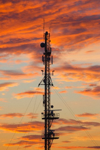Telecommunications mast at sunset