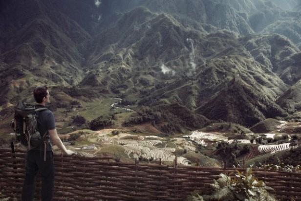 Traveler before an Asian landscape